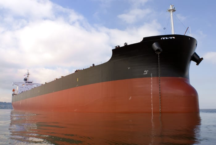 Ship with bottom half red color and top half black color.