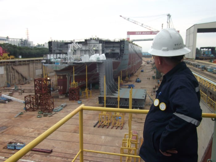 Proceanic employee looking over ship.
