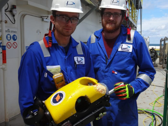 Two Proceanic employees holding ROV