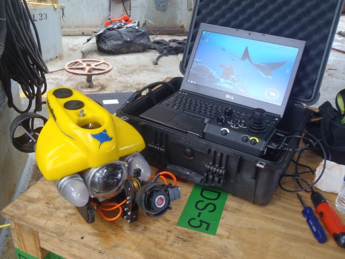 ROV next to laptop on table